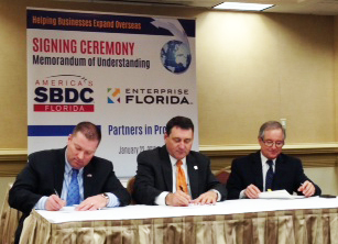 Florida SBDC CEO and Network State Director Michael Myhre (left), Secretary of Commerce and EFI President and CEO Gray Swoope (center), and EFI Senior Vice President of International Trade Manny Mencia (right) sign a MOU solidifying a partnership between the Florida SBDC and EFI.