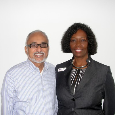 Vasu Vasudevan, President and CEO of Infotech Systems, and Florida SBDC at UCF Government Contracting Specialist Patricia Simpson