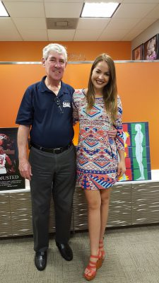 Elaine Cruz-Abril, owner of Express Life Chiropractic, and Gary Cole Sr., a Florida SBDC at Fort Lauderdale business consultant