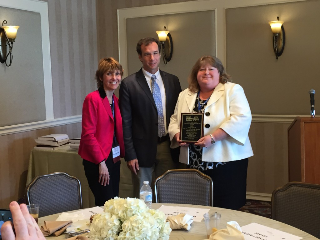 Jill Kaufman (right), Florida SBDC at UCF Assistant Director and SBI Program Manager, accepts one of UCF's awards from Denise Cumberland, SBI VP of Research and Publications, and John Batchelor, SBI President
