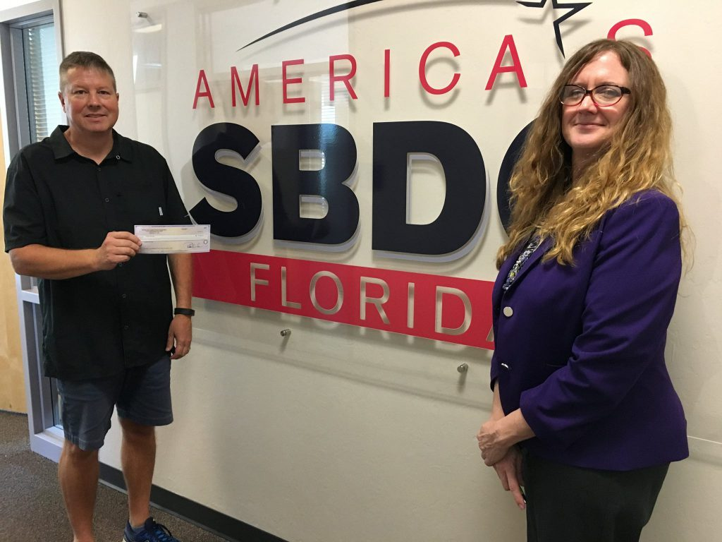 Best Moving and Storage owner Robert McHugh and Suzanne Specht, assistant director for the Florida SBDC at FGCU