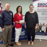 Anne Lang (left), President of Busy Kids Creative Learning Center, worked with the Florida SBDC at USF and the Highlands County Board of County Commissioner's Economic Development office to secure an emergency bridge loan for the business following Hurricane Irma.