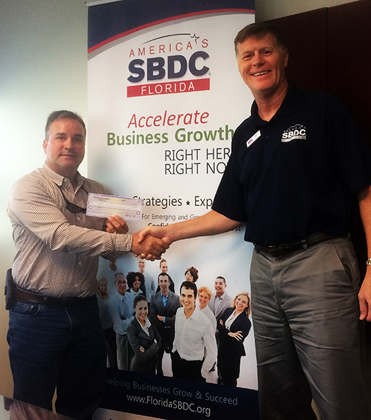 Joseph Welbourn (left), Owner of Carbon Marine, worked with the Florida SBDC at USF to secure an emergency bridge loan for the business following Hurricane Irma.