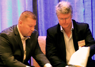Florida SBDC CEO and Network State Director Michael Myhre (left) and FFCFC President and CEO Todd Kocourek (right) sign a MOU solidifying a partnership between the Florida SBDC and FFCFC.