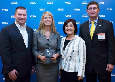 """L-R: Michael W. Myhre, CEO and Network State Director, Florida SBDC; Jill McLaughlin, FSBDC at UCF International Trade Specialist and 2014 Florida State Star; Eunice Choi, FSBDC at UCF Regional Director; and Charles """"Tee"""" Rowe, President/CEO, America's SBDC"""