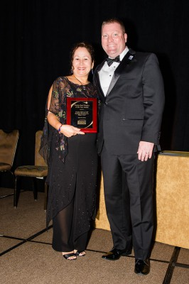 Eileen Rodriguez, Regional Director for the Florida SBDC at USF, accepts the Florida SBDC Network Florida Best Practice Award from Michael Myhre