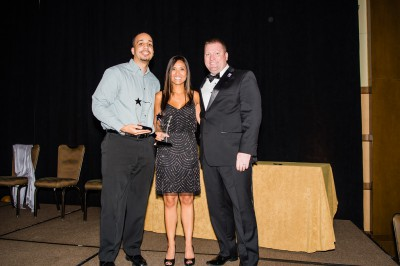 (L-R): Jairo Batista and Marice Hague accept the Florida SBDC Network Florida Employee of the Year Award from Michael Myhre