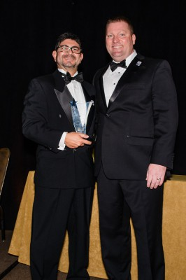 Javier Marin (left) accepts the Florida SBDC Network Florida Star of the Year award from Michael Myhre (right)
