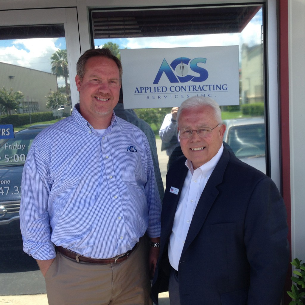 Applied Contracting Services co-owner Wes Stapp with Florida SBDC at UCF consultant Hunt Dawkins