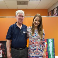 Elaine Cruz-Abril, owner of Express Life Chiropractic, and Gary Cole Sr., a Florida SBDC at Fort Lauderdale consultant