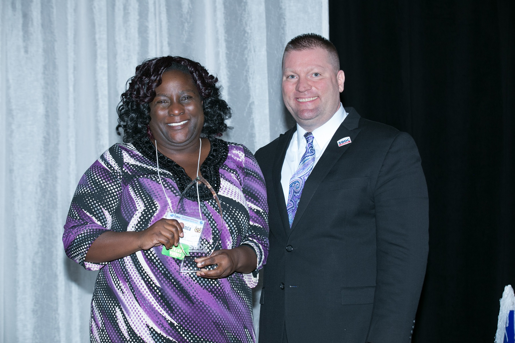L-R: Yolanda Cowart, a business consultant for the Florida SBDC at Pinellas County Economic Development, receives the Florida SBDC's 2017 State Star Award from Michael Myhre, CEO and Network State Director