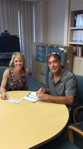 Bell Engineering owner Randolph Bell closes on his emergency bridge loan with Florida SBDC at PBSC consultant Debbie Kwon.