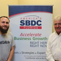 Tristan Sothern, owner of Circuit Motorsports, and Roger Greenwald, Florida SBDC at UCF