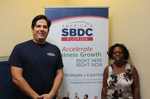 Daniel Quiroz (left), Owner of Delivery Signs, worked with consultant Pauline Davis from the Florida SBDC at UCF to secure an emergency bridge loan for the business following Hurricane Irma.