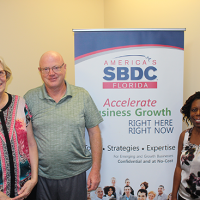 Sandra Metcalf (left), President of Pet Lodge & Spa, worked with consultant Pauline Davis from the Florida SBDC at UCF to secure an emergency bridge loan for the business following Hurricane Irma.