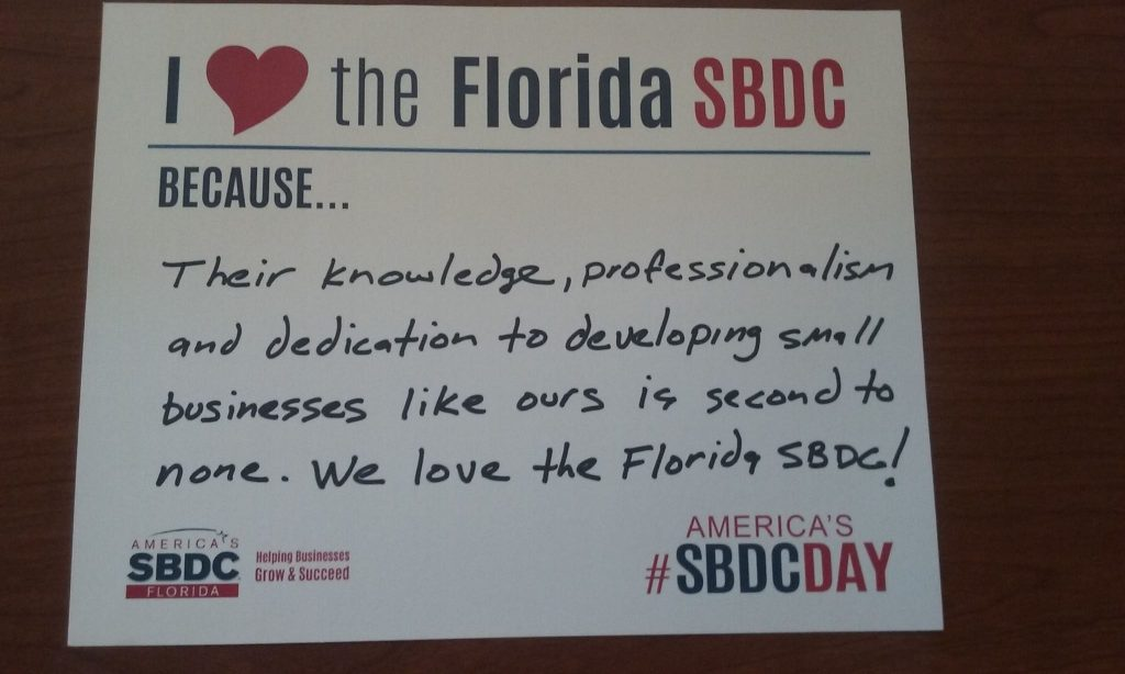 Example sign with I love the Florida SBDC because... message from a client